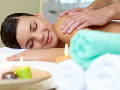 Woman enjoying a massage in a spa.